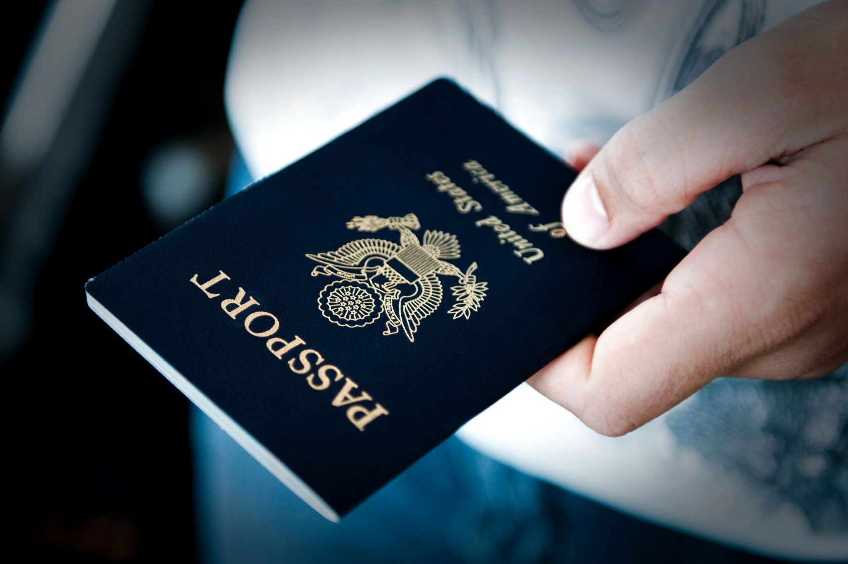 10313003 - image of a persons hand holding a passport