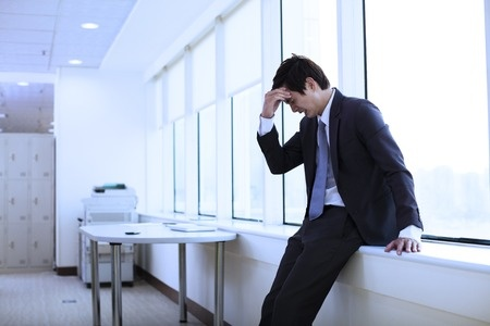 42479082 - depressed young businessman in office